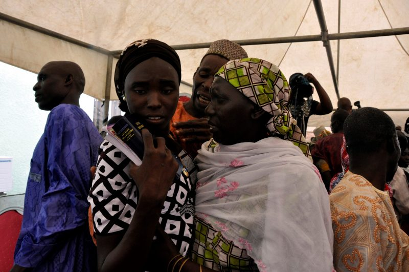 ABUJA, NIGERIA - OCTOBER 16: Nigerian girls kidnapped by terrorist group Boko Haram, meet with their families after they were released, during a ceremony at a Church in Abuja, Nigeria on October 16, 2016. Sodiq Adelakun / Anadolu Agency