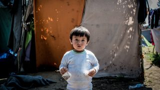 A boy at a makeshift refugee camp on the Serbian side of the border with Hungary near the town of Horgos on August 12, 2016. (Photo by Guillaume Pinon/NurPhoto)