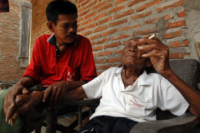 An Indonesian man, named Mbah Gotho, claimed to be 146 years old, is the oldest human in world's history speaks to press members at his family house in Sragen, Central Java, Indonesia on August 29, 2016.  The civil registry office recorded parents born on December 31, 1870, age Mbah Gotho exceed men the oldest in the world that used to be held by French woman named Jeanne Calment lived to be 122 years old, his life Mbah Gotho have four wives and his last wife died in 1988. All of the children also had died and now his family is left ie, grandchildren, great-grandchildren, and great-great grandson. Dasril Roszandi (Photo by Dasril Roszandi/NurPhoto)