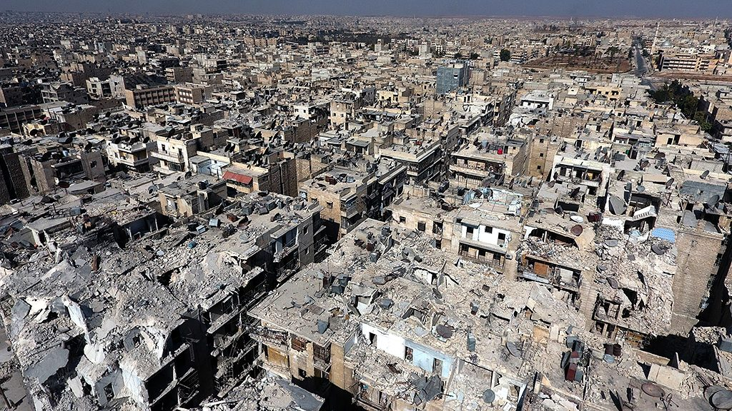 ALEPPO, SYRIA - OCTOBER 7: An aerial view of the buildings destroyed by the Assad Regime forces and Russian Army in the Tariq al-Bab neighborhood of Aleppo, Syria on October 2016.  (Photo by Jawad al Rifai/Anadolu Agency/Getty Images)