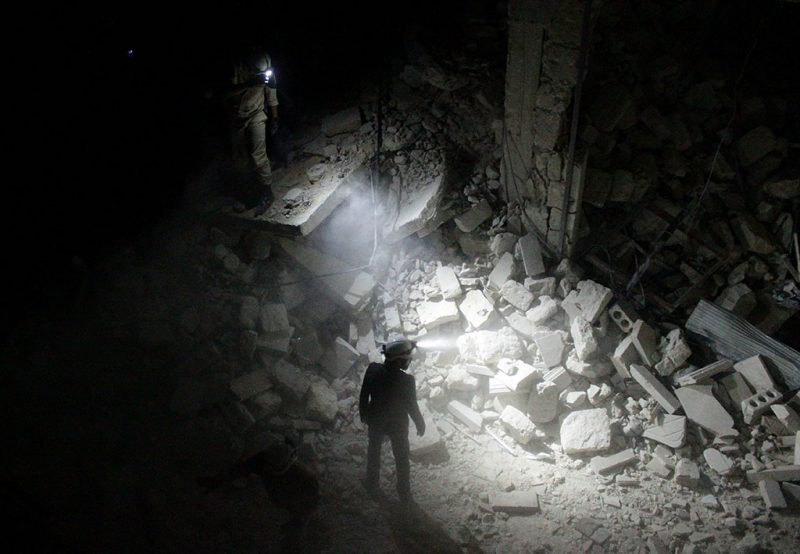 ALEPPO, SYRIA - JULY 09: Search and rescue team members inspect collapsed buildings after Asad Regime forces' attack on residential areas in Karm al-Beik region of Aleppo, Syria on July 09, 2015. (Photo by Beha El Halebi/Anadolu Agency/Getty Images)