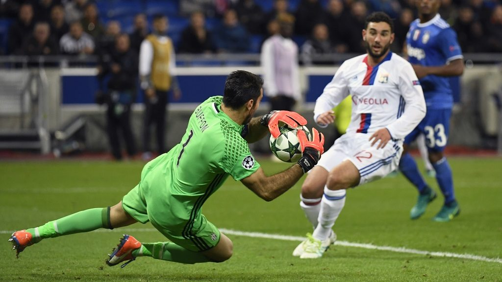 """Juventus' Italian goalkeeper Gianluigi Buffon (L) stops the ball in front of  Lyon's French midfielder Jordan Ferri (R) during the Champions League football match between Olympique Lyonnais and Juventus on October 18, 2016  at the Parc Olympique Lyonnais stadium in Decines-Charpieu near Lyon, southeastern France.    / AFP PHOTO / PHILIPPE DESMAZES / """"The erroneous mention[s] appearing in the metadata of this photo by PHILIPPE DESMAZES has been modified in AFP systems in the following manner: [Juventus' Italian goalkeeper Gianluigi Buffon (L) stops the ball in front of  Lyon's French midfielder Jordan Ferri (R) during the Champions League football match between Olympique Lyonnais and Juventus on October 18, 2016  at the Parc Olympique Lyonnais stadium in Decines-Charpieu near Lyon, southeastern France.   ] instead of Juventus' Italian goalkeeper Gianluigi Buffon (L) stops the ball in front of Juventus' Brazilian defender Alex Sandro (R) during the Champions League football match between Olympique Lyonnais and Juventus on October 18, 2016  at the Parc Olympique Lyonnais stadium in Decines-Charpieu near Lyon, southeastern France.   ]. Please immediately remove the erroneous mention[s] from all your online services and delete it (them) from your servers. If you have been authorized by AFP to distribute it (them) to third parties, please ensure that the same actions are carried out by them. Failure to promptly comply with these instructions will entail liability on your part for any continued or post notification usage. Therefore we thank you very much for all your attention and prompt action. We are sorry for the inconvenience this notification may cause and remain at your disposal for any further information you may require."""""""