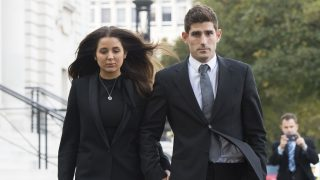 CARDIFF, WALES - OCTOBER 14:  Chesterfield F.C football player Ched Evans leaves Cardiff Crown Court with partner Natasha Massey after being found not guilty of rape on October 14, 2016 in Cardiff, Wales. The former Wales striker was jailed in 2012 for raping a 19-year-old woman, but had his conviction quashed by the Court of Appeal in April.  (Photo by Matthew Horwood/Getty Images)