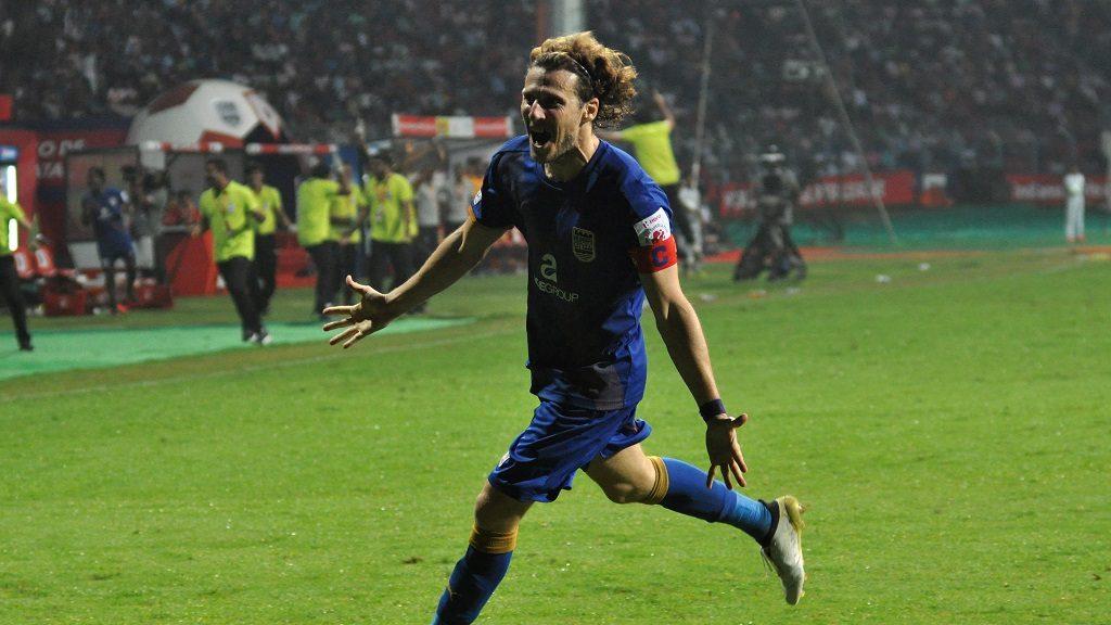 Mumbai City FC player Diego Forlan Corazzo celebrates after scoring during the Indian Super League football match between Atletico de Kolkata and Mumbai City FC in Kolkata on October 25, 2016. / AFP PHOTO / STR