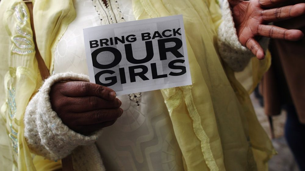 LONDON, ENGLAND - MAY 09:  A woman holds a sign that reads 'Bring back our girls' during a protest outside Nigeria House on May 9, 2014 in London, England. 276 schoolgirls were abducted from their boarding school on 14 April, 2014 in the town of Chibok in north-eastern Borno state in Nigeria. The abductions have sparked protests around the world calling for the release of the girls who are being held by the militant group Boko Haram.  (Photo by Dan Kitwood/Getty Images)