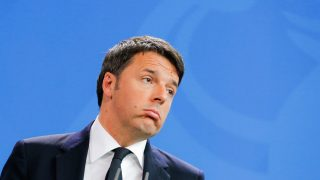 BERLIN, GERMANY - JANUARY 29: Italy Prime Minister Matteo Renzi reacts during speaking to the media with German Chancellor Angela Merkel (not pictured) following talks at the Chancellery on January 29, 2016 in Berlin, Germany. Bilateral relations and the European policy on the current refugee situation within Europe were the main topics of their meeting. (Photo by Christian Marquardt/Getty Images)