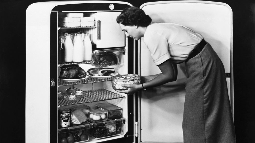 The cream enamel, 76A, electric, refrigerator has an internal capacity of 7.6 cubic meters, and incorporates adjustable shelving and fully automatic lighting. (Photo by © Hulton-Deutsch Collection/CORBIS/Corbis via Getty Images)