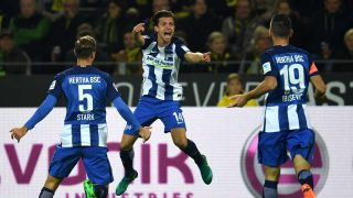Hertha's Swiss midfielder Valentin Stocker (c) and his teammates celebrate scoring during the German first division Bundesliga football match between BVB Borussia Dortmund and Hertha BSC Berlin in Dortmund, western Germany on October 14, 2016. / AFP PHOTO / PATRIK STOLLARZ / RESTRICTIONS: DURING MATCH TIME: DFL RULES TO LIMIT THE ONLINE USAGE TO 15 PICTURES PER MATCH AND FORBID IMAGE SEQUENCES TO SIMULATE VIDEO. == RESTRICTED TO EDITORIAL USE == FOR FURTHER QUERIES PLEASE CONTACT DFL DIRECTLY AT + 49 69 650050
