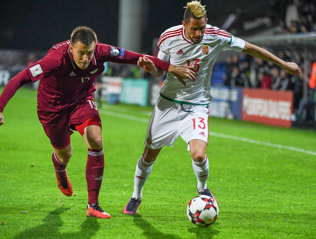 Latvia's Vitalijs Jagodinskis (L) vies with Hungray's Adam Gyursco (R) during the WC 2018 football qualification match between Latvia and Hungary in Riga on October 10, 2016.  / AFP PHOTO / Ilmars ZNOTINS
