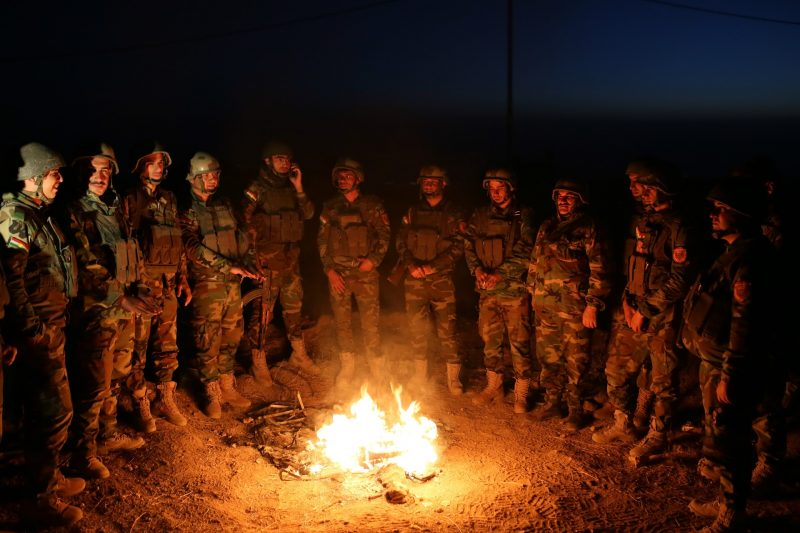 MOSUL, IRAQ - OCTOBER 17 : Peshmerga forces gather around a fire at Mosul's Bashiqah Zardak mountain as they wait for the start of the operation to retake Iraq's Mosul from Deash in Iraq on October 17, 2016. A much anticipated Mosul offensive to liberate the city from Daesh began midnight Sunday, according to Iraqi Prime Minister Haider al-Abadi. Yunus Keles / Anadolu Agency