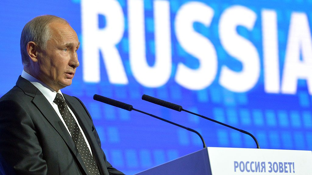 """Russian President Vladimir Putin gives a speech at the 8th annual VTB Capital """"Russia Calling!"""" Investment Forum in Moscow on October 12, 2016. / AFP PHOTO / SPUTNIK / ALEXEI DRUZHININ"""