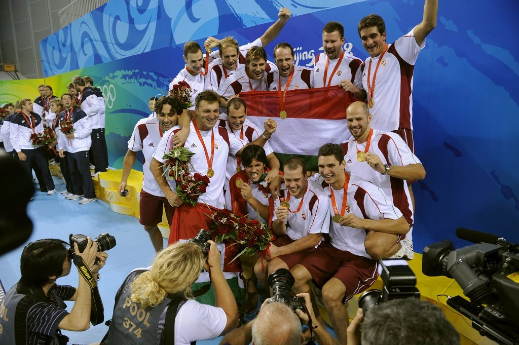 Hungary's men's water polo team pose for pictures after receiving the gold medal for beating the US during the men's gold medal water polo match at the 2008 Beijing Olympic Games on August 24, 2008. Hungary won 14-10. AFP PHOTO/FRED DUFOUR / AFP PHOTO / FRED DUFOUR