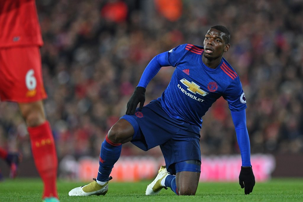 Manchester United's French midfielder Paul Pogba picks himself up off the floor during the English Premier League football match between Liverpool and Manchester United at Anfield in Liverpool, north west England on October 17, 2016. The game finished 0-0. / AFP PHOTO / Paul ELLIS / RESTRICTED TO EDITORIAL USE. No use with unauthorized audio, video, data, fixture lists, club/league logos or 'live' services. Online in-match use limited to 75 images, no video emulation. No use in betting, games or single club/league/player publications.  /