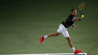 Spanish Tommy Robredo returns the ball to Serbian Novak Djokovic during their ATP tennis match on the first round of the Dubai Duty Free Tennis Championships on February 22, 2016.  / AFP PHOTO / KARIM SAHIB