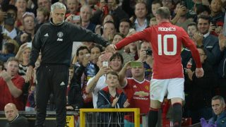 Manchester United's English striker Wayne Rooney (R) touches hands with Manchester United's Portuguese manager Jose Mourinho (L) as he leaves the pitch after being substituted during the friendly Wayne Rooney testimonial football match between Manchester United and Everton at Old Trafford in Manchester, northwest England, on August 3, 2016.  / AFP PHOTO / OLI SCARFF