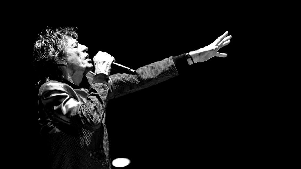 INDIO, CA - OCTOBER 14: (EDITORS NOTE: Image has been converted to black and white.) Singer Mick Jagger of The Rolling Stones performs during Desert Trip at the Empire Polo Field on October 14, 2016 in Indio, California.   Kevin Winter/Getty Images/AFP