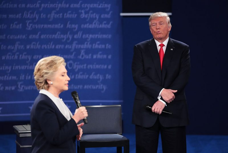 ST LOUIS, MO - OCTOBER 09:  Democratic presidential nominee former Secretary of State Hillary Clinton (L) speaks as Republican presidential nominee Donald Trump listens during the town hall debate at Washington University on October 9, 2016 in St Louis, Missouri. This is the second of three presidential debates scheduled prior to the November 8th election.  (Photo by Scott Olson/Getty Images)