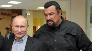 Russia's President Vladimir Putin and American action movie actor Steven Seagal visit a newly-built sports complex of Sambo-70 prominent wrestling school in Moscow. Putin teamed up today  with Steven Seagal to promote the Soviet-style regime of rigorous physical training for schoolchildren. Sambo is the official in-house martial art of the KGB security services which Putin practiced before switching to judo. AFP PHOTO/ RIA-NOVOSTI/ POOL / ALEXEI NIKOLSKY / AFP PHOTO / RIA-NOVOSTI / ALEXEI NIKOLSKY