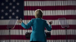 Democratic presidential nominee Hillary Clinton speaks during a rally at the Cleveland Public Auditorium November 6, 2016 in Cleveland, Ohio. Donald Trump barnstorms five states Sunday while Hillary Clinton implores her most fervent supporters to get to the polls, in a frenetic final 48-hour dash to the US presidential election. / AFP PHOTO / Brendan Smialowski