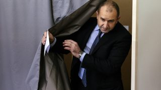 Former head of the Bulgarian airforce Rumen Radev, candidate of the opposition Socialist Party, leaves a polling booth before casting his ballot at a polling station during the presidential elections in Sofia on November 13, 2016.  Bulgarians voted in a high-stakes presidential run-off that could see centre-right Prime Minister Boyko Borisov's government fall if his handpicked candidate fails to defeat a Socialist-backed general. / AFP PHOTO / DIMITAR DILKOFF