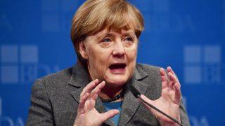 German Chancellor Angela Merkel addresses guests at a meeting of the Confederation of German Employers' Associations (BDA - Bundesvereinigung der Deutsche Arbeitgeberverbaende) in Berlin on November 15, 2016. / AFP PHOTO / John MACDOUGALL