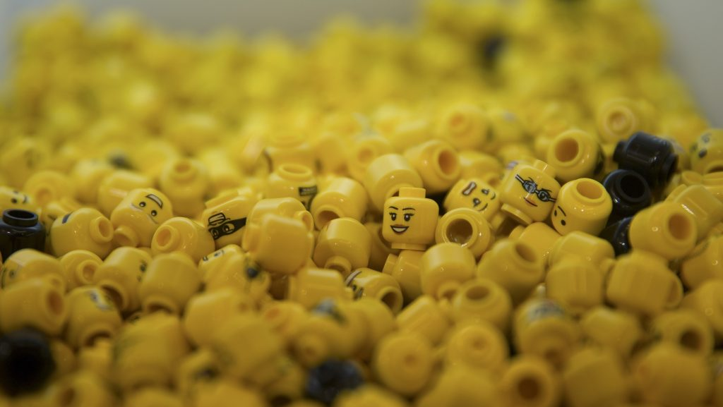 LEGO heads are pictured on display during the official opening of  the new LEGO store in Leicester Square, central London in November 17, 2016.  Billed as the world's largest LEGO store by the company, the new UK flagship store was officially opened on November 17 in Leicester Square. / AFP PHOTO / Daniel LEAL-OLIVAS