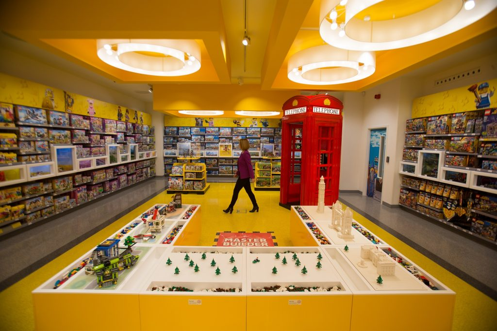 A LEGO employee poses for a picture on one of the floors of the new LEGO store in Leicester Square, central London in November 17, 2016.  Billed as the world's largest LEGO store by the company, the new UK flagship store was officially opened on November 17 in Leicester Square. / AFP PHOTO / Daniel LEAL-OLIVAS