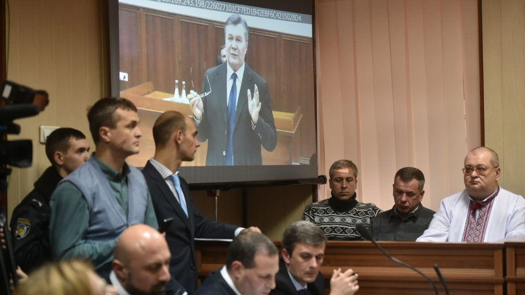 Former Ukrainian president Viktor Yanukovych is seen via live video link from Russia on a screen at a courtroom as he is questioned on his role in the killing of more than 100 people during Kiev's February 2014 pro-EU revolt, in Kiev on November 28, 2016.  Ukraine's so-called Euromaidan protests lasted three months and culminated in a bloodbath that claimed the lives of more than 100 largely unarmed people and about 20 anti-riot police. / AFP PHOTO / Genya SAVILOV