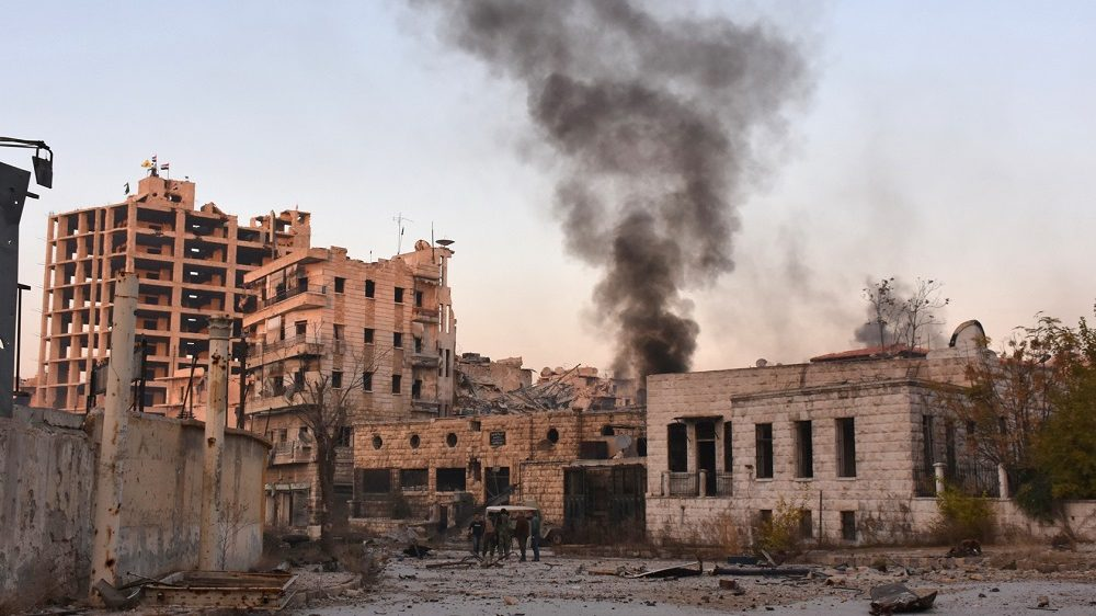 Smoke billows in Aleppo's Bustan al-Basha neighbourhood on November 28, 2016, during Syrian pro-government forces assault to retake the entire northern city from rebel fighters. Government forces have retaken a third of rebel-held territory in Aleppo, forcing nearly 10,000 civilians to flee as they pressed their offensive to retake Syria's second city. In a major breakthrough in the push to retake the whole city, regime forces captured six rebel-held districts of eastern Aleppo over the weekend, including Masaken Hanano, the biggest of those in eastern Aleppo.   / AFP PHOTO / GEORGE OURFALIAN