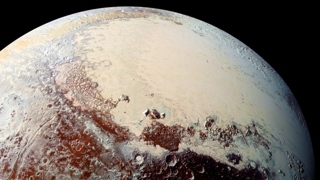 """This NASA image captured by NASA's New Horizons spacecraft released October 15, 2015 shows combined blue, red and infrared images taken by the Ralph/Multispectral Visual Imaging Camera (MVIC). The bright expanse is the western lobe of the """"heart,"""" informally called Sputnik Planum, which has been found to be rich in nitrogen, carbon monoxide and methane ices. Pluto contains a rich variety of colors on its surface, according to the observations from NASA's New Horizons probe and its first published science results Thursday. From dark red parts at the equator of the dwarf planet to lighter and bluer regions at higher latitudes, the findings have stunned astronomers.  """"I was astonished to see such spectacular surface color and geological diversity,"""" said Silvia Protopapa, an assistant research scientist in astronomy at the University of Maryland and part of the New Horizons surface composition team. AFP PHOTO/JHUAPL/SWRI = RESTRICTED TO EDITORIAL USE- MANDATORY CREDIT """"AFP PHOTO /NASA/JHUAPL/SWRI """" -NO MARKETING NO ADVERTISING CAMPAIGNS - DISTRIBUTED AS A SERVICE TO CLIENTS =       / AFP PHOTO / NASA / HO"""