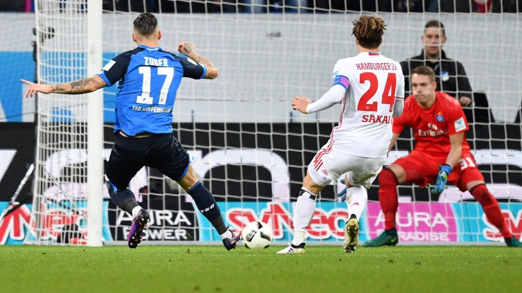 Hoffenheim's Steven Zuber (l) shoots the 2:1 goal during the Bundesliga soccer match between TSG1899 Hoffenheim and Hamburger SV at Rhein-Neckar-Arena in Sinsheim, Germany, 20 November 2016. PHOTO: UWE ANSPACH/dpa  (EMBARGO CONDITIONS - ATTENTION: Due to the accreditation guidlines, the DFL only permits the publication and utilisation of up to 15 pictures per match on the internet and in online media during the match.)