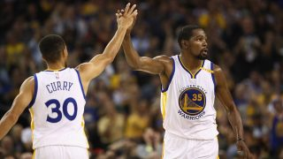 OAKLAND, CA - NOVEMBER 09: Stephen Curry #30 high-fives Kevin Durant #35 of the Golden State Warriors during their game against the Dallas Mavericks at ORACLE Arena on November 9, 2016 in Oakland, California. NOTE TO USER: User expressly acknowledges and agrees that, by downloading and or using this photograph, User is consenting to the terms and conditions of the Getty Images License Agreement.   Ezra Shaw/Getty Images/AFP