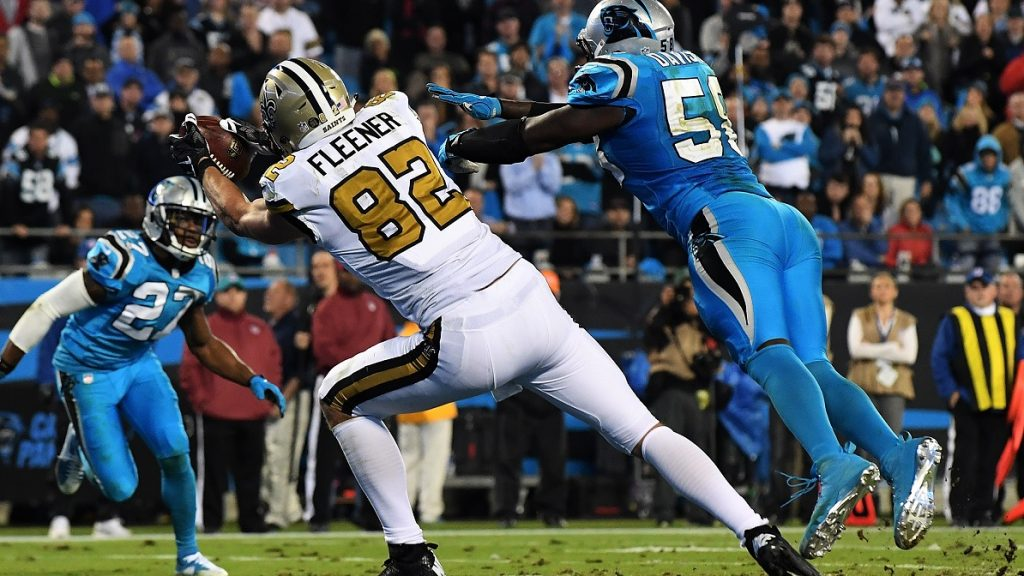 CHARLOTTE, NC - NOVEMBER 17: Coby Fleener #82 of the New Orleans Saints makes a touchdown reception against the Carolina Panthers at Bank of America Stadium on November 17, 2016 in Charlotte, North Carolina.   Mike Comer/Getty Images/AFP
