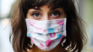 Young woman with respirator on the face