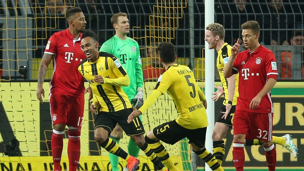 Dortmund's Pierre-Emerick Aubameyang (2.f.L) cheers after his 1-0 goal during the German Bundesliga match between Borussia Dortmund and Bayern Munich in Signal Iduna Park, Dortmund,Germany, 19 November 2016. photo:INAFASSBENDER/dpa  (EMBARGOCONDITIONS - ATTENTION - Due to the accreditation guidelines, the DFLonly permits the publication and utilisation of up to 15 pictures per match on the internet and in online media during the match)