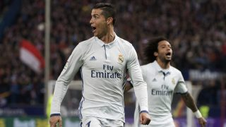 Real Madrid's Portuguese forward Cristiano Ronaldo (R) celebrates after scoring during the Spanish league football match Club Atletico de Madrid vs Real Madrid CF at the Vicente Calderon stadium in Madrid, on November 19, 2016. / AFP PHOTO / CURTO DE LA TORRE