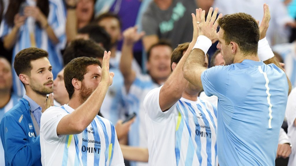 Argentina's tennis player Joan Martin del Potro (front R) celebrates after winning the Davis Cup World Group final singles match between Croatia and Argentina at the Arena hall in Zagreb, on November 25, 2016. / AFP PHOTO / STRINGER