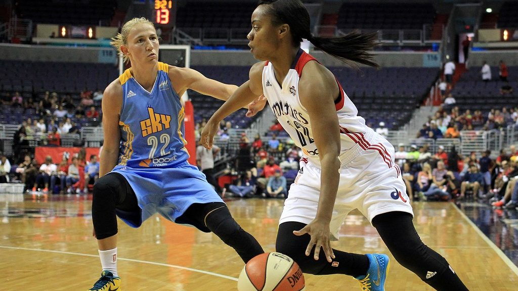 August 23 2015: Washington Mystics guard Ivory Latta (12) dribbles past Chicago Sky guard Courtney Vandersloot (22) during a WNBA game at Verizon Center, in Washington D.C. Chicago won 66-64. (Photo by Tony Quinn/Icon Sportswire/Corbis via Getty Images)