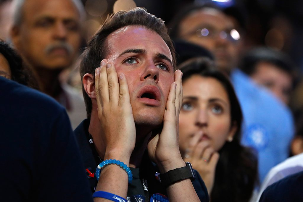 NEW YORK, NY - NOVEMBER 08:  A man reacts as he watches voting results at Democratic presidential nominee former Secretary of State Hillary Clinton's election night event at the Jacob K. Javits Convention Center November 8, 2016 in New York City. Clinton is running against Republican nominee, Donald J. Trump to be the 45th President of the United States.  (Photo by Aaron P. Bernstein/Getty Images)