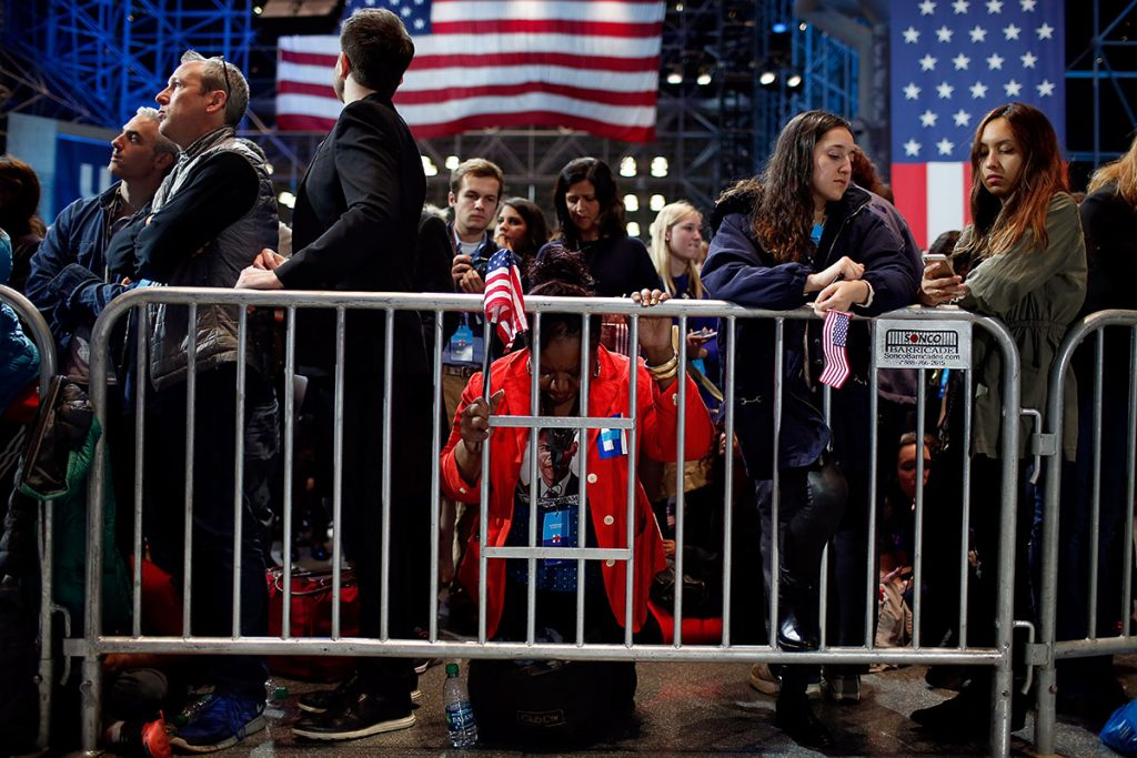 NEW YORK, NY - NOVEMBER 09:  Marta Lunez prays on her knees as election results come in at Democratic presidential nominee former Secretary of State Hillary Clinton's election night event at the Jacob K. Javits Convention Center November 9, 2016 in New York City. Clinton is running against Republican nominee, Donald J. Trump to be the 45th President of the United States.  (Photo by Win McNamee/Getty Images)