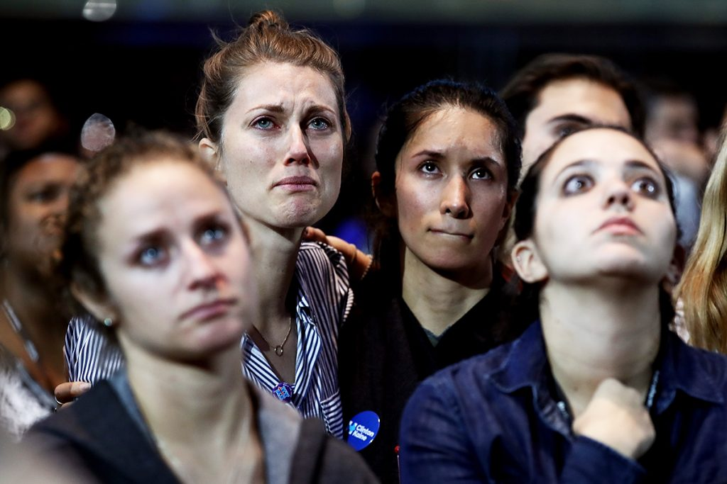 NEW YORK, NY - NOVEMBER 09:  People react to the voting results at Democratic presidential nominee former Secretary of State Hillary Clinton's election night event at the Jacob K. Javits Convention Center November 9, 2016 in New York City. Clinton is running against Republican nominee, Donald J. Trump to be the 45th President of the United States.  (Photo by Win McNamee/Getty Images)