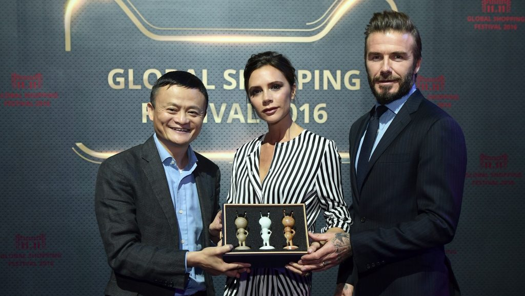 SHENZHEN, CHINA - NOVEMBER 09: (L-R) Alibaba chairman Jack Ma, British fashion designer Victoria Beckham and British former footballer David Beckham pose for a photo during a dress rehearsal ahead of Gala of 11.11 Global Shopping Festival on November 09, 2016 in Shenzhen, Guangdong Province of China. Alibaba Group will hold a gala of the 11.11 Global Shopping Festival at Shenzhen Universiade Sports Centre on the night before November 11.  (Photo by VCG/VCG via Getty Images)