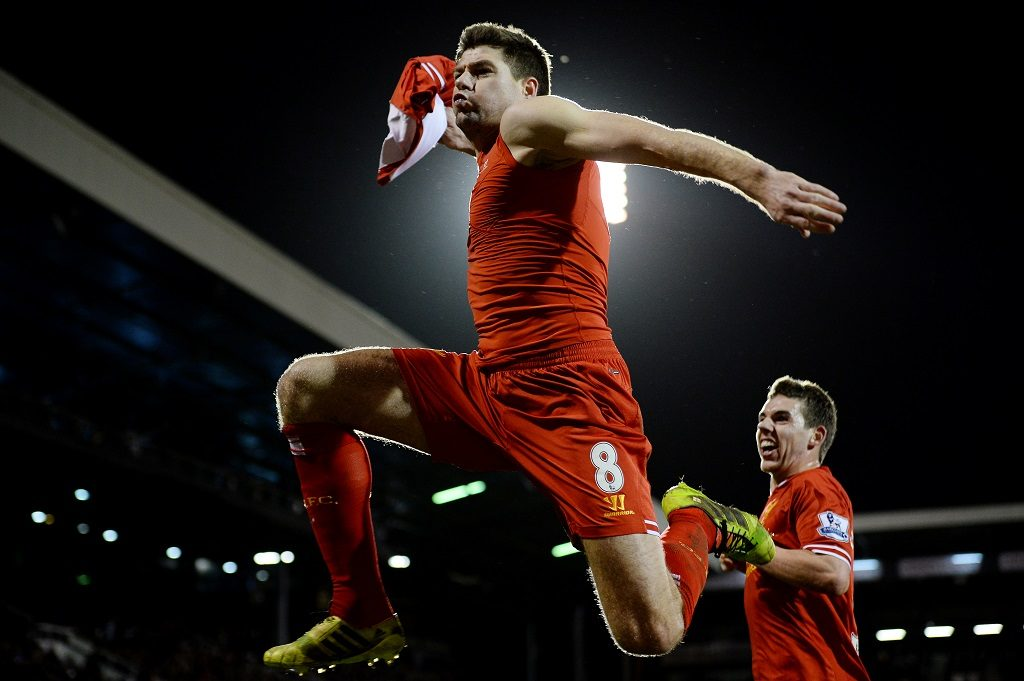 LONDON, ENGLAND - FEBRUARY 12:  Steven Gerrard of Liverpool celebrates scoring the late winning goal from the penalty spot during the Premier League match between Fulham and Liverpool at Craven Cottage on February 12, 2014 in London, England. (Photo by Marc Atkins/Mark Leech Sports Photography/Getty Images)