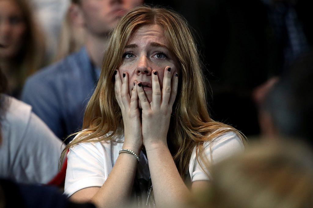 NEW YORK, NY - NOVEMBER 08:  A woman reacts as she watches voting results at Democratic presidential nominee former Secretary of State Hillary Clinton's election night event at the Jacob K. Javits Convention Center November 8, 2016 in New York City. Clinton is running against Republican nominee, Donald J. Trump to be the 45th President of the United States.  (Photo by Win McNamee/Getty Images)
