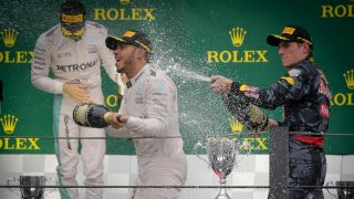 SAO PAULO, BRAZIL - NOVEMBER 13: Lewis Hamilton (C), Nico Rosberg (R) and Max Verstappen (L)  celebrate on the podium of the Formula One Grand Prix of Brazil at Autodromo Jose Carlos Pace in Sao Paulo, Brazil on November 13, 2016. Dario Oliveira / Anadolu Agency