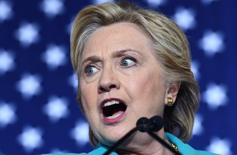 US Democratic presidential nominee Hillary Clinton speaks during a campaign rally at the Dickerson Community Center in Daytona, Florida, on October 29, 2016.  Clinton embarks this weekend on the frenetic final 10 days of her White House campaign, determined to shake off renewed controversy over the FBI probe into her private emails. The 69-year-old Democrat -- vying to become America's first female president -- is still the frontrunner to win the November 8 election over her Republican rival Donald Trump.  / AFP PHOTO / Jewel SAMAD