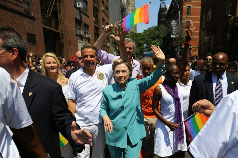 NEW YORK, NY - JUNE 26: Democratic Presidential candidate Hillary Clinton (C) greets people as she marches in the 46th annual New York City Gay Pride Parade in New York, New York, USA, on 26 June 2016. (Photo by Volkan Furuncu/Anadolu Agency/Getty Images)