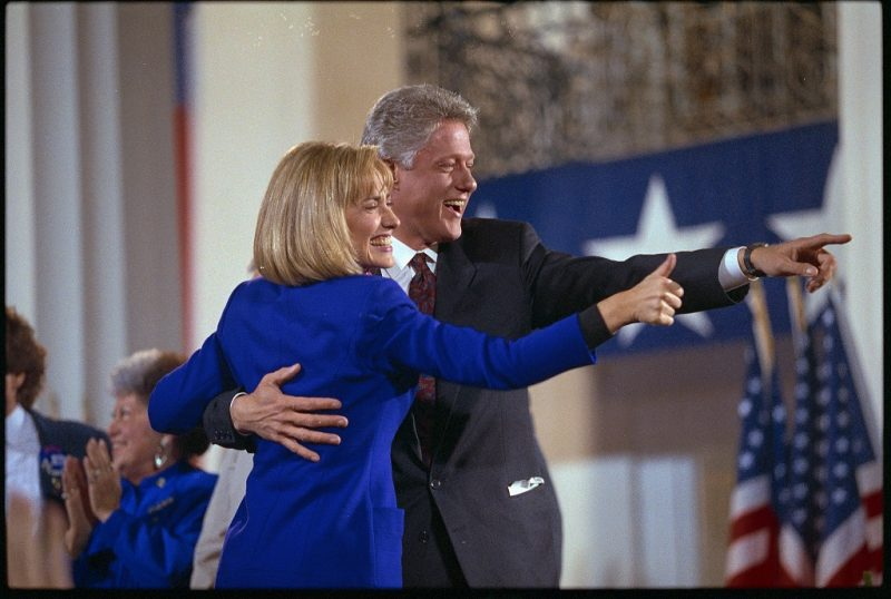 President-elect Bill Clinton and his wife, Hillary, acknowledge the crowd of supporters at a victory celebration at the Old State House in Little Rock following the 1992 election.   (Photo by David Turnley/Corbis/VCG via Getty Images)