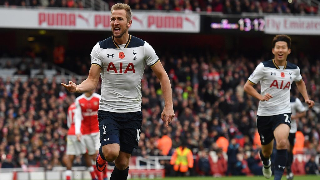 Tottenham Hotspur's English striker Harry Kane (L) celebrates scoring his team's first goal from the penalty spot during the English Premier League football match between Arsenal and Tottenham Hotspur at the Emirates Stadium in London on November 6, 2016.  / AFP PHOTO / BEN STANSALL / RESTRICTED TO EDITORIAL USE. No use with unauthorized audio, video, data, fixture lists, club/league logos or 'live' services. Online in-match use limited to 75 images, no video emulation. No use in betting, games or single club/league/player publications.  /