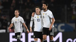 HANOVER, GERMANY - OCTOBER 11: Sami Khedira of Germany celebrates scoring his sides second goal with Mesut Oezil of Germany during the FIFA 2018 World Cup Qualifier between Germany and Northern Ireland at HDI-Arena on October 11, 2016 in Hanover, Lower Saxony.  (Photo by Stuart Franklin/Bongarts/Getty Images)